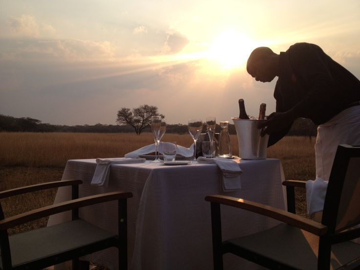 Setting up for romantic anniversary sundowners overlooking the plain at Lilayi