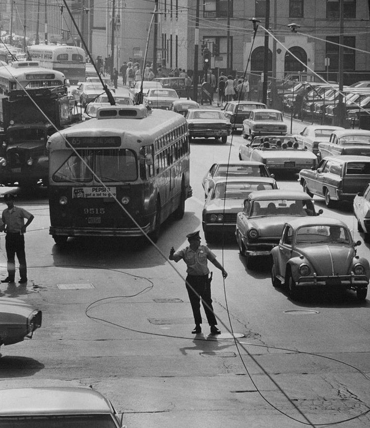 Grand and Rush streets in Chicago, July 13, 1970: Overhead trolley wires snapped, stopping traffic at rush hour. Photo by Don Casper (Vintage Tribune)