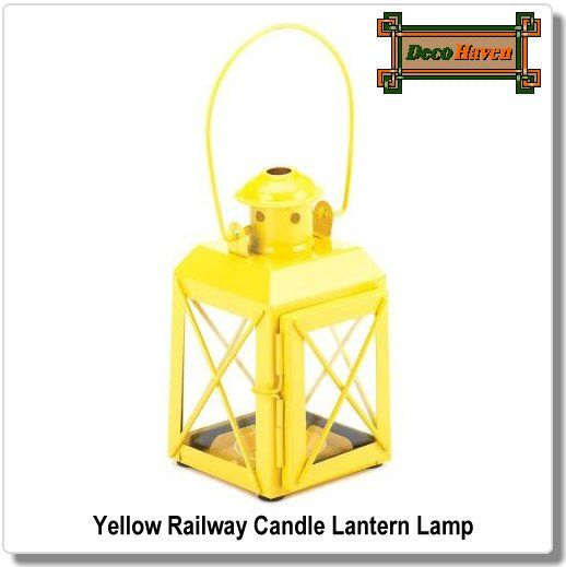 Yellow Railway Candle Lantern Lamp - This charming railroad-style candle lantern features a large handle and hinged door. Brighten your living space, indoors or outdoors, with a pop of vibrant yellow and the shimmering shine of candlelight.