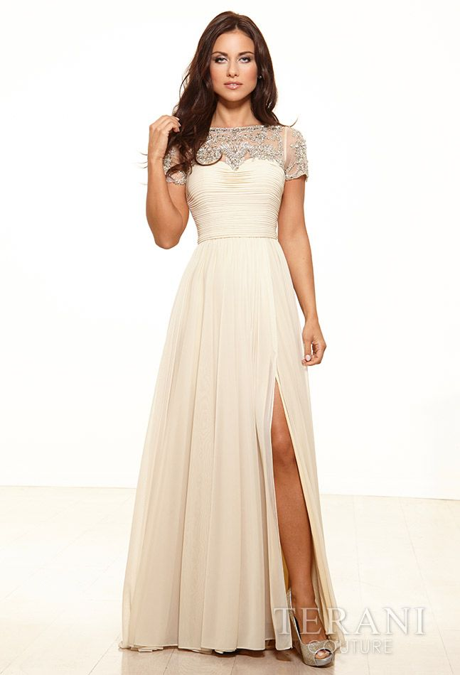 M2218 Cap sleeve gown with mock sweetheart bodice and mesh chest embellished with an array of crystals and sequins Colors : Champagne, Rose, Turquoise