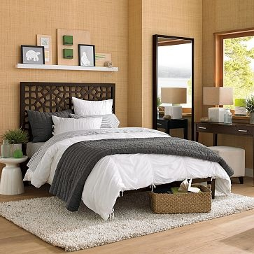 master bedroom - art shelf above bed