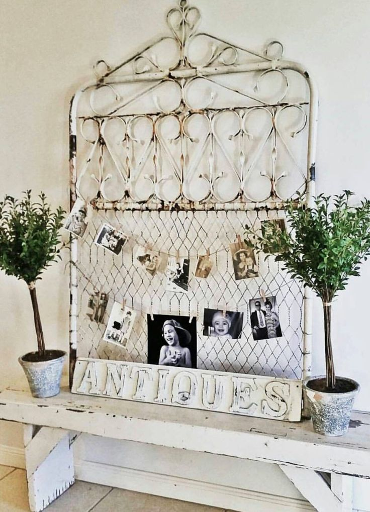 Use an old gate not only for home decor but to add old pictures to it. This is part of the salvaged farmhouse home tour #ssmfeature me with vintage bliss
