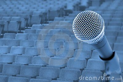 Stock Photo: Before A Conference/Concert  (Microphone In Front Of Empty Chairs)
