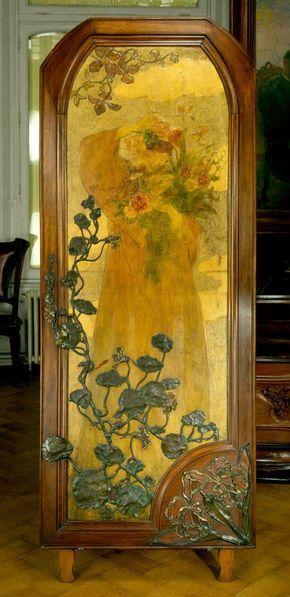 Art Nouveau door panel c1900 by Victor Prouvé.  Hammered, repoussé, pyrograve, gilt and painted wood with bronze decoration.  Ecole de Nancy - cuir Prouvé