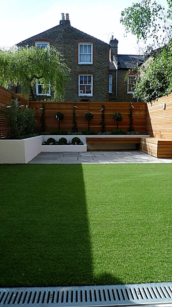 modern garden design courtyard easy lawn grass cedar hardwood privacy screen trellis low maintenance planting sandstone patio paving London ...