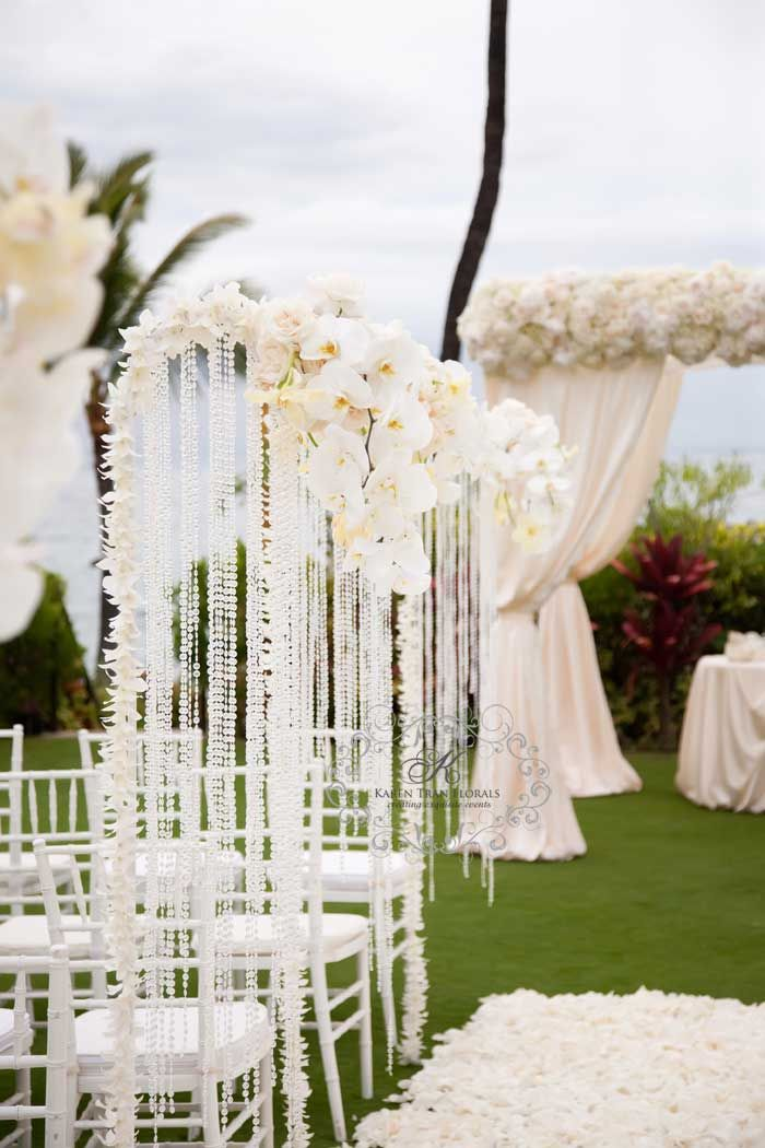 Hanging crystals helped this stunning @Mandy Bryant Bryant Bryant Dewey Seasons Resort Maui outdoor aisle sparkle even more.