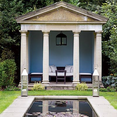 Neoclassicism, a meditation hut, with greece inspired columns in front and lush greenery around the outside