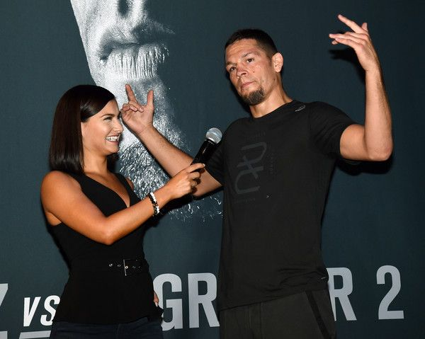 Megan Olivi Photos Photos - UFC host and reporter Megan Olivi (L) interviews mixed martial artist Nate Diaz during an open workout for UFC 202 at Rocks Lounge at the Red Rock Casino on August 18, 2016 in Las Vegas, Nevada. Diaz is scheduled to fight UFC featherweight champion Conor McGregor in a welterweight rematch at UFC 202 on August 20, 2016 in Las Vegas. - UFC 202 - Open Workouts