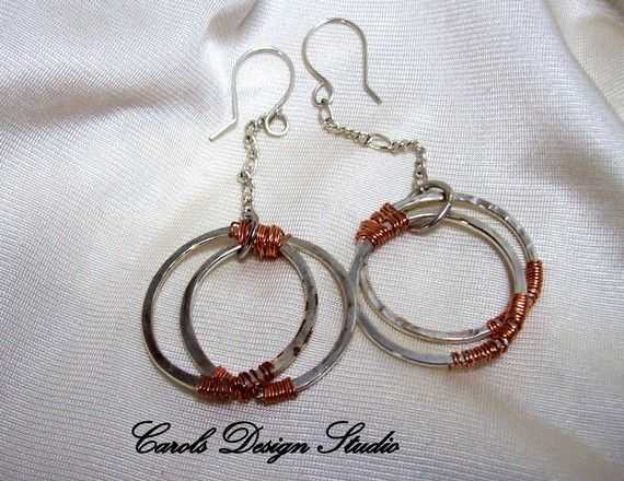 This lovely combination of silver with copper accents dangles lightly 3 1/4 inches from top to bottom.  For more beautiful jewelry designs and custom orders please go to www.Carol'sStudio.etsy.com  All the items you see here are handmade by me and are one of a kind. I might make another of an item but it will not be identical. Always I strive to use only the best ingredients available.   #etsy #design #handmade #gifts