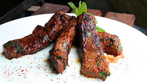 Barbecued lamb  recipe (mechoui) with minted yoghurt