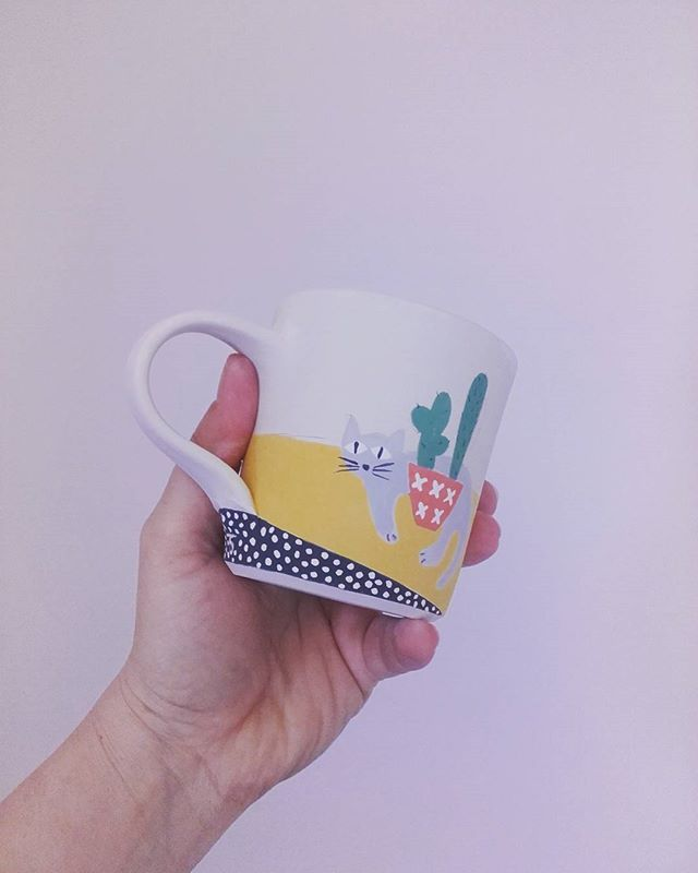 Cat & Cactus mug ready for firing 😊🌵🍵 what a beautiful spring day. Back home,  unpacked, a full line of washing out and expecting rain. The ants moved in while we were on holiday 😖🐜🐜🐜 - - - #australianmade #australianceramics #tasmanianceramics #cat #cactus #mug #potter #amugshot