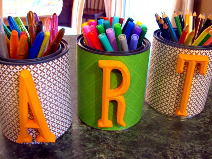 I love this project of covering paint cans with scrapbook paper or whatever you have and some words to create space for crafting material. This could be used in many rooms, for many functions actually. IHeart Organizing: March Featured Space: Kids - Color Your World