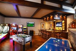 Contemporary Game Room with High ceiling, Tornado Tournament 3000 Foosball Table, Hardwood floors, Dirty Drivin Arcade