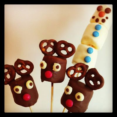 chocolate dipped marshmallow treats designed to be reindeer and snowmen - how neat!?!?