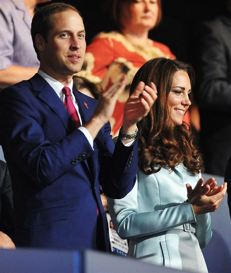 Prince William, Duke of Cambridge, and Catherine, Duchess of Cambridge, applaud during the Opening Ceremony of the London 2012 Olympic Games.