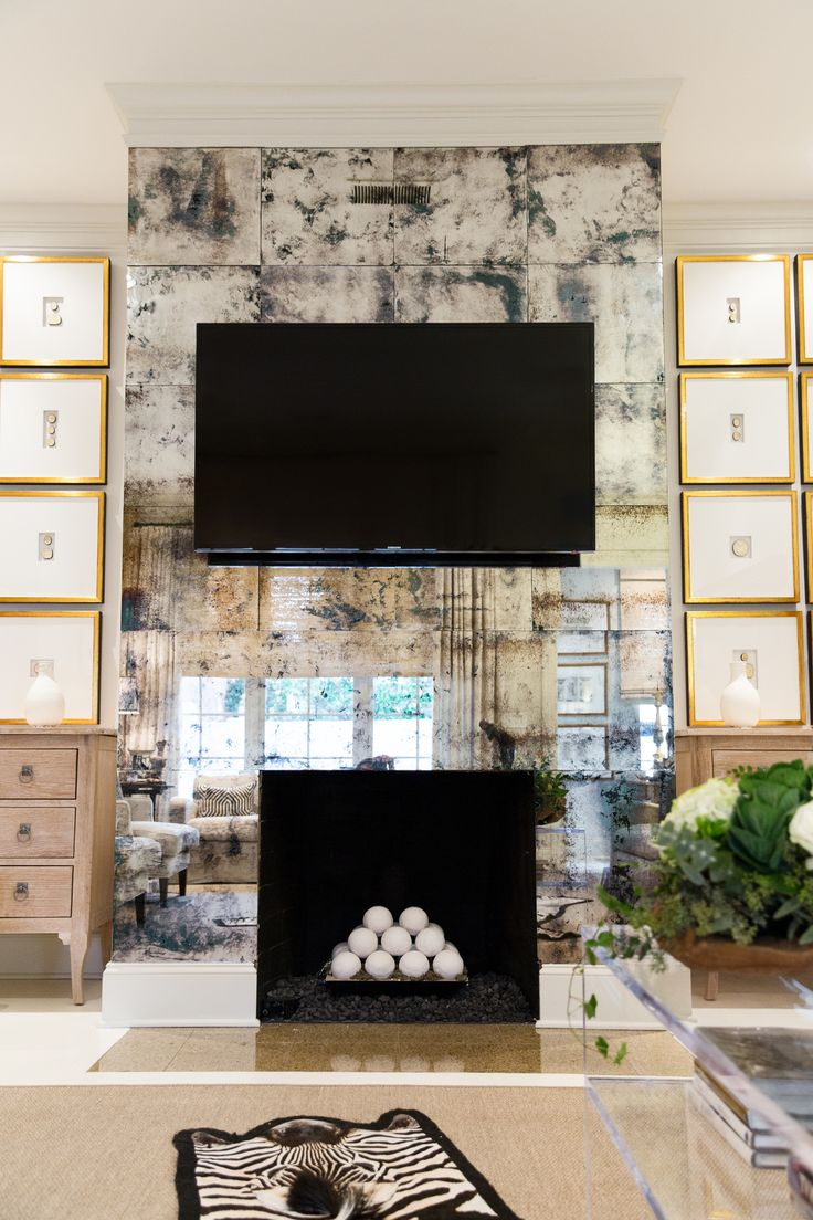 Antiqued Mirror Wall Tutorial by @amyhowardhome. Mirrored spaces are the designer's secret way to make smaller areas seem larger.