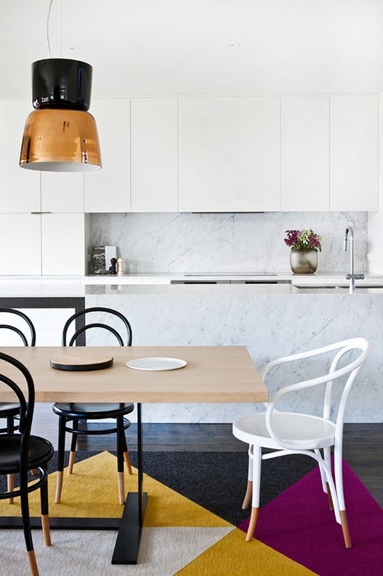Love the lamp, colours, chairs and the fact that the marble in this kitchen suits everything beautifly.
