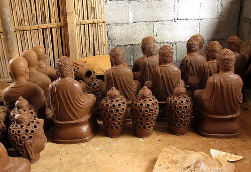 "Ceramic, Kasongan. We stopped at a small ""factory"" (really just a cluster of sheds and a kiln) where an all-Muslim workforce makes hundreds of life-size and larger Buddha images for hotels and restaurants around the world."