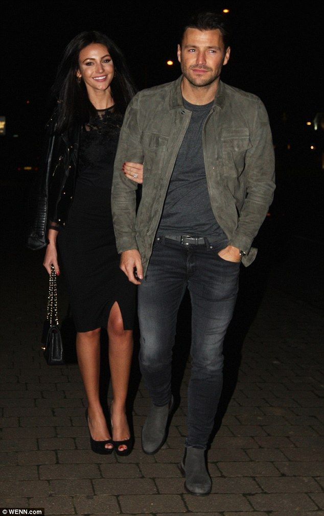Cute couple:Michelle Keegan looked as loved-up as ever with Mark Wright as she cuddled up to him at his father's 60th Birthday party in Essex on Tuesday