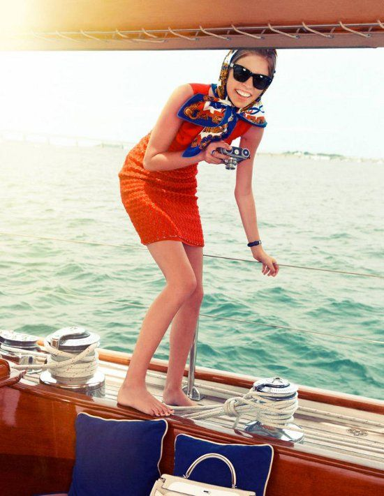 Reminds me of Jackie Kennedy sailing. This photo shoot is crazy identical of an actual picture of her.