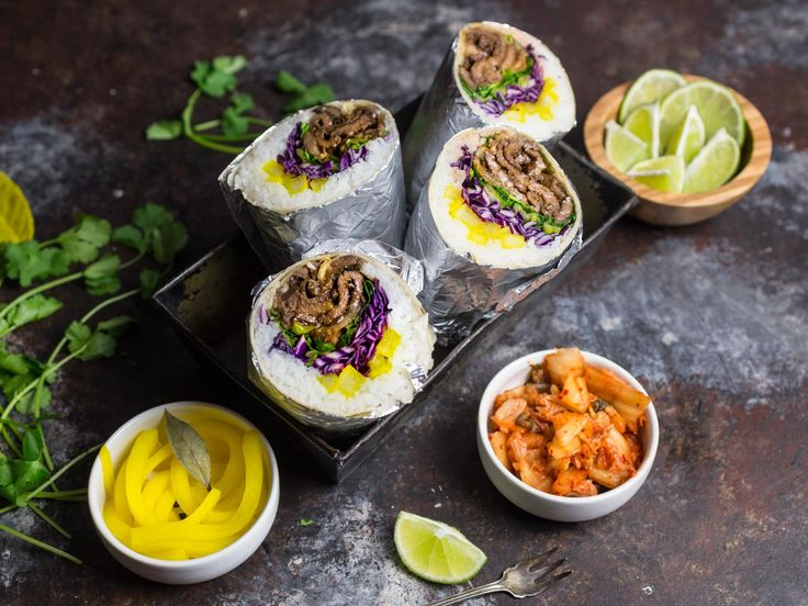 These beef bulgogi burritos are a fusion dish, combining the essentials of traditional Korean bulgogi in a delicious wrapped burrito. Loaded with flavorful add-ins, like kimchi and pickled daikon radish, they're a winner for the mouth and the eyes.
