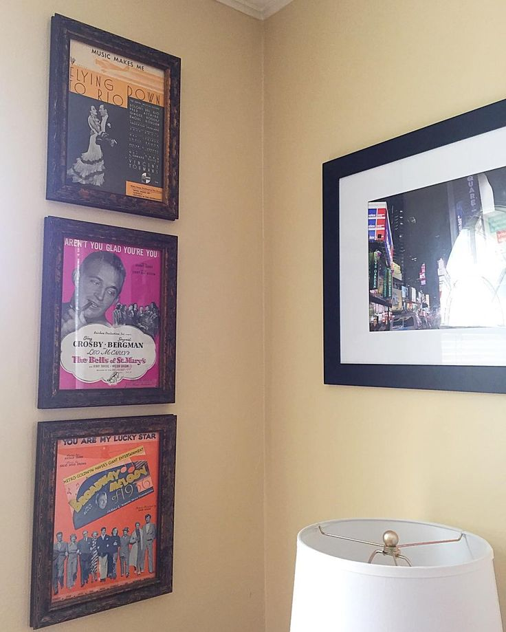 """That """"narrow/small wall"""" that needed love somehow. A heart for #timeless #musicaltheatre = #sheetmusic of #bingcrosby and #fredastaire. A self-taken 11x14 of NYC on the opposite wall feels #justright (and makes the heart long to live in #nyc again ALL THE TIME).  Vintage style sheet music frames (9x12) from Hobby Lobby. #smallspace #smallspaceliving #mystyle #home #homedecor #homesweethome #design #oklahomacity #okc #missingnyc by kristinstang8"""