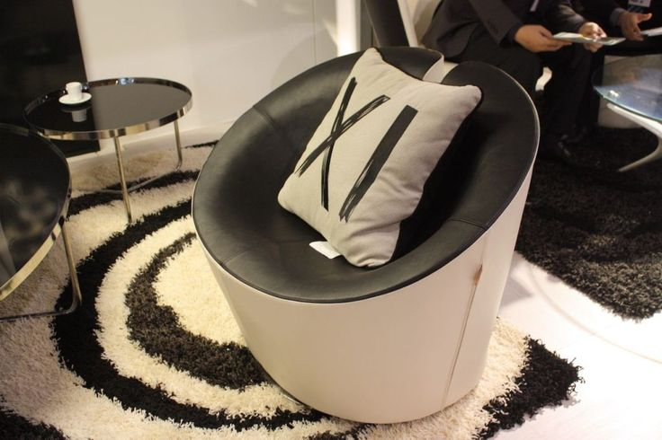 A thoroughly modern living room chair is this one from XI Custom. Available in you choice of upholstery fabrics, this black and white version is great.