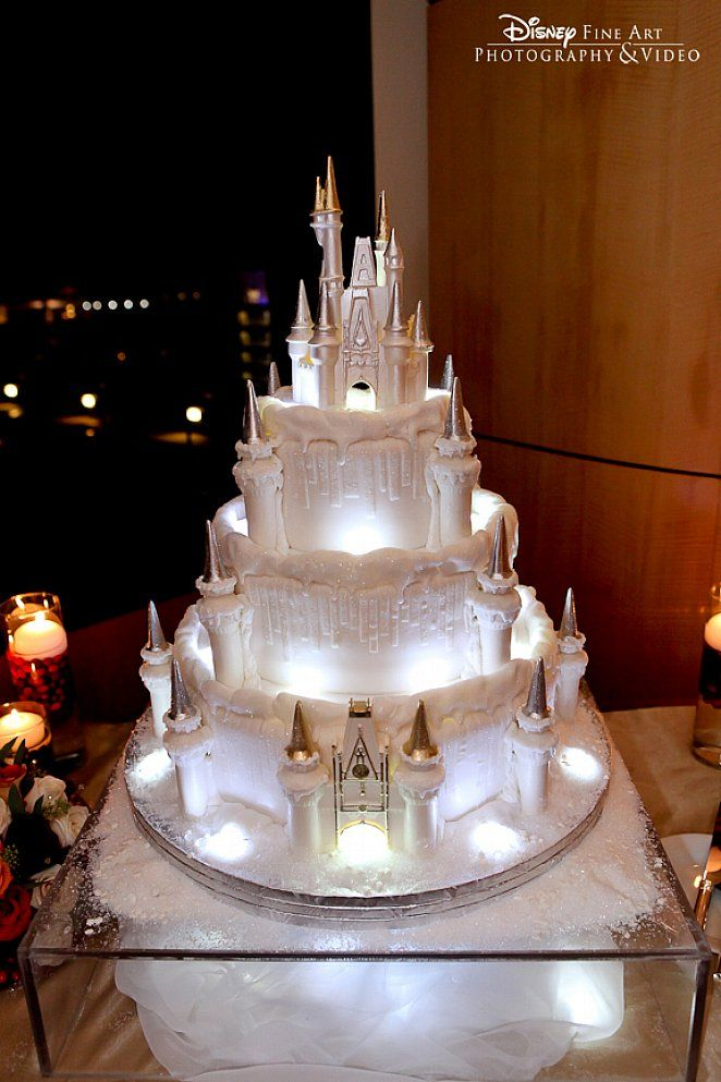 cinderellthemed wedding scroll invitations%0A White castle wedding cake with Cinderella Castle Disney topper  LED lights  and sparkle