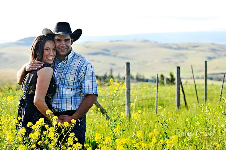 Engagement photography of cowboy and cowgirl with horses in a yellow field, very rustic in Kamloops, BC.  Italian. Quesnel, Williams Lake and Cariboo BC Engagement Photography Photographer.  Available worldwide.  Engagements | Robyn Louise Photography Engagements | Robyn Louise Photography www.robynlouise.com #engagement #bc #williams #lake #photography #quesnel #cariboo #wedding #photographer #robynlouise #kamloops