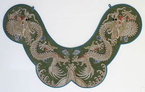 This embroidered silk collar is in excellent condition with detailed designs of dragons amid swirling clouds - late Qing 19th