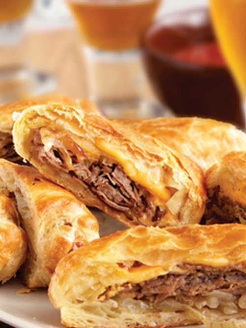 Recipe for Philly Cheesesteak Rolls - These upscale cheesesteak sandwiches feature flaky puff pastry instead of ordinary rolls. They're easy to make, and even easier to enjoy!