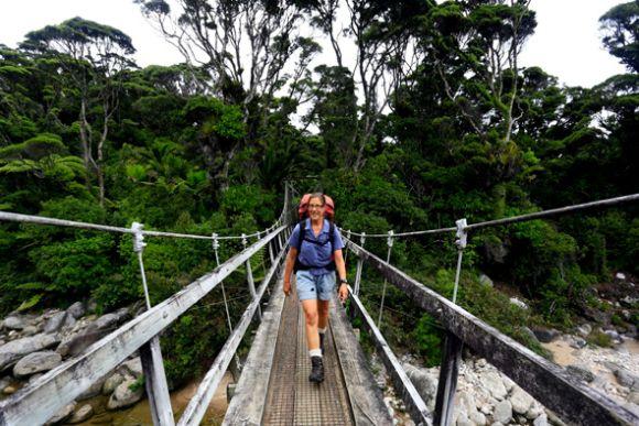 Volunteer Hut Warden Anja Scholz walking the Heaphy Track in Kahurangi National Park.