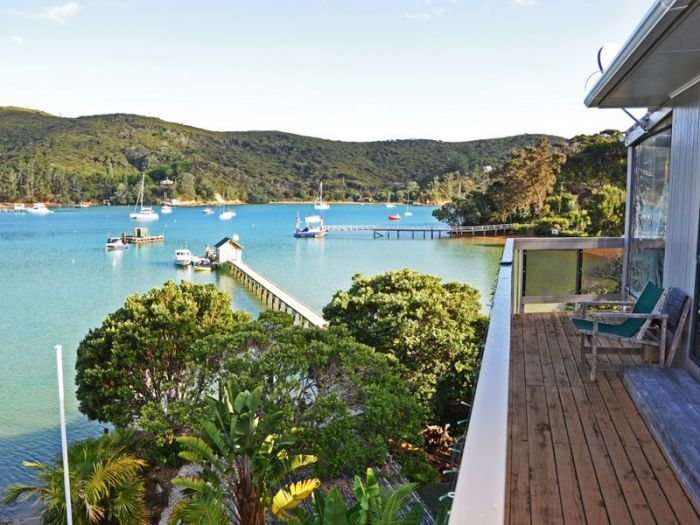 Lot 102, North Cove, Kawau Island. Located right on the water in sheltered North Cove , but elevated just enough to provide a commanding view over the bay, this home has everything required for comfortable waterside living. From the moment you disembark on to the floating pontoon alongside your all tide jetty, you are reminded that you have something very unique and special. For ease of access you can moor your boat alongside the pontoon in all weather, or use your own deepwater mooring in…