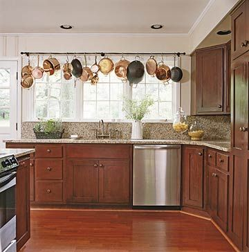 """Lots of kitchen organization ideas here, but I really like this """"valance"""" made from copper pots."""