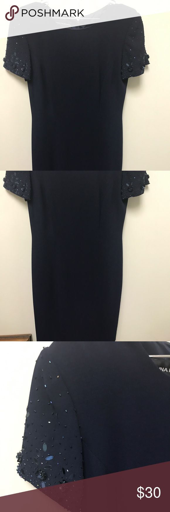 Donna Morgan Navy with sequence dress Beautiful Donna Morgan navy dress with vintage buttons down the back - sequence sleeves.. Donna Morgan Dresses Midi