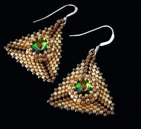 A Vitrail color Swarovski crystal rivoli complimented by gold and light bronze Miyuki Delicas seed beads.