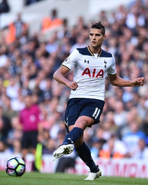 Tottenham Hotspur's Argentinian midfielder Erik Lamela passes the ball during the English Premier League football match between Tottenham Hotspur and Manchester City at White Hart Lane in London, on October 2, 2016. / AFP / Glyn KIRK / RESTRICTED TO EDITORIAL USE. No use with unauthorized audio, video, data, fixture lists, club/league logos or 'live' services. Online in-match use limited to 75 images, no video emulation. No use in betting, games or single club/league/player publications.  /