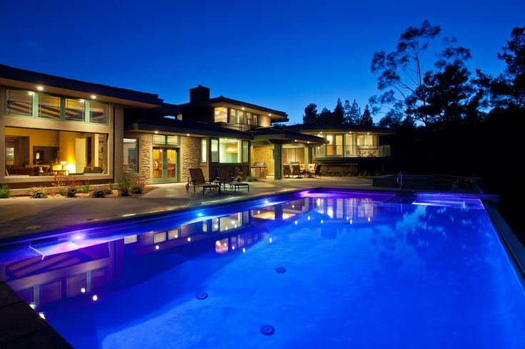 At night the pool comes alive with color reflecting the beautiful architecture of the home