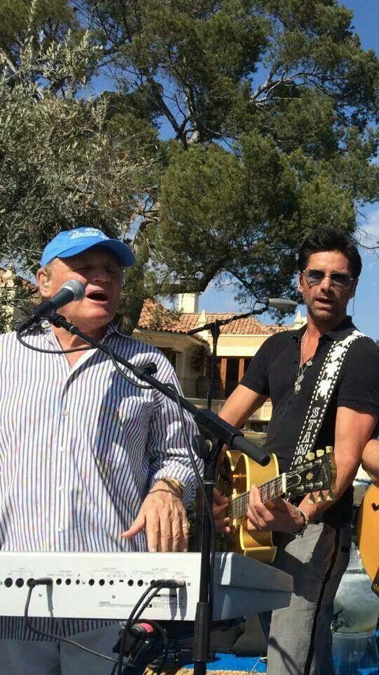 John Stamos playing with the Beach Boys