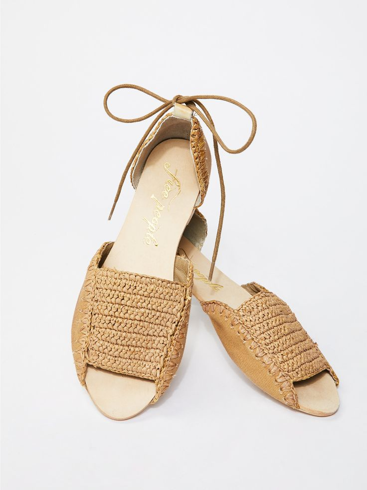 Beaumont Woven Flat   Woven open toe flats featuring leather sides. * Adjustable lace-up ties * Slight stacked heel * Sizing Tip: This style runs true to size. If between sizes, size up.