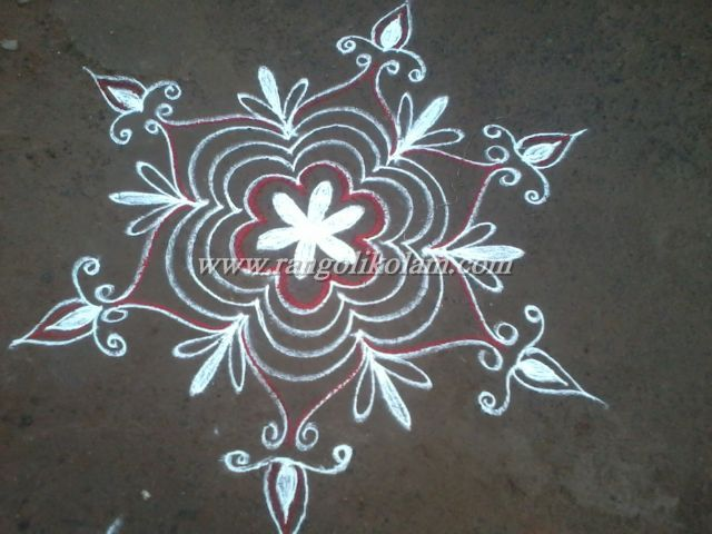 Its freehand style simple design kolam on morning with kavi colour