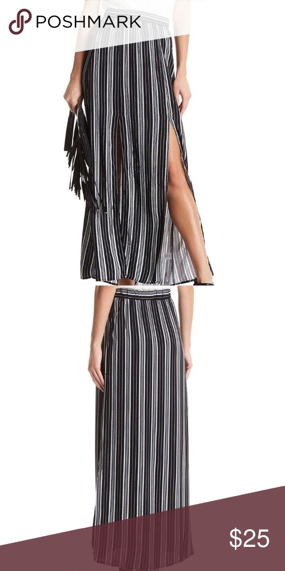 "Stripped Maxi Skirt with Slit A striped print maxi skirt with front slits for easy mobility but still delivers a versatile and fashionable look.   •Pull-on style  •Elastic hem  •Allover print  •Knit construction  •Front Slit detail  •~41"" in length Love, Fire Skirts Maxi"