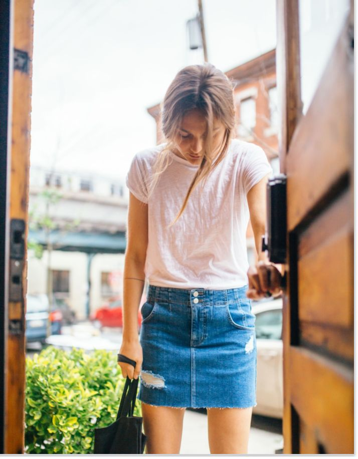 Corsette Mini Skirt Denim mini skirt featuring allover distressing detailing and a raw hem. Super stretch denim Adjustable buckle in back Five-pocket style Zip fly