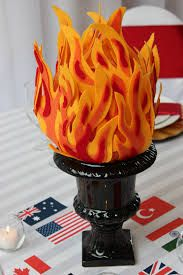 flame centrepiece - easy to make - felt and glue, maybe in a glass in glass vase filled with orange beads