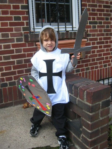 Get creative and make your own DIY Knight costume for your child. Paint a  cross