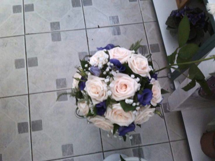 Apricot roses and purple lisianthus