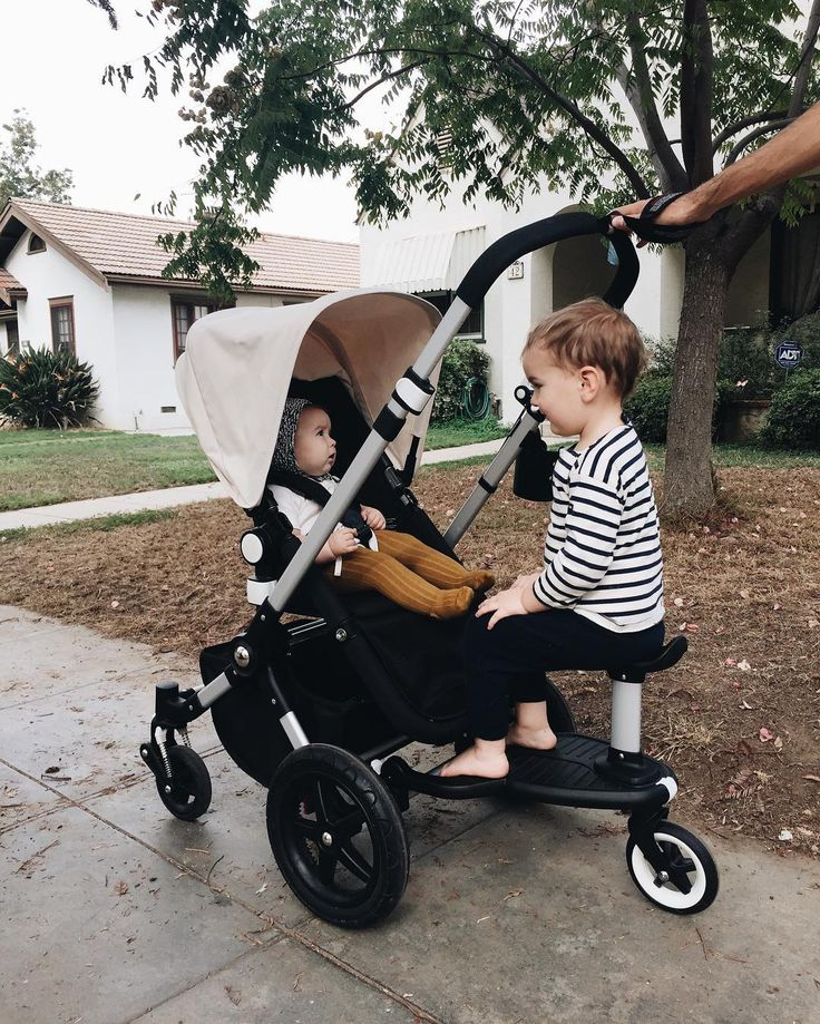 we finally found a setup for walking with a baby and a toddler! i tried a tandem stroller but it was too bulky. and even though adam can walk i wouldn't rely on it for longer distances! our solution? we got this wheeled board attachment so adam can ride along or hop off to walk when he pleases. we bring a carrier in case edie gets fussy and then adam can take her place in the seat!