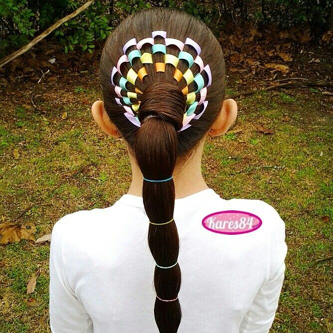 Ponytail with colorfull ribbons woven around it!