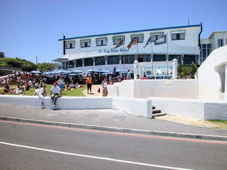 One of the best drinking holes in the Western Cape. The Blue Peter where people relax, drink and watch the sunset. The Village Bloubergstrand Cape Town