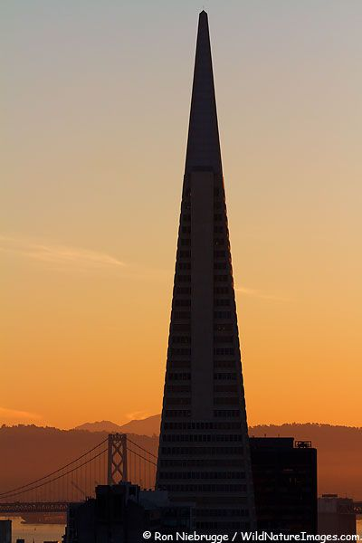 Transamerica Pyramid and the Bay Bridge at sunrise, San Francisco, California; photo by Ron Niebrugge